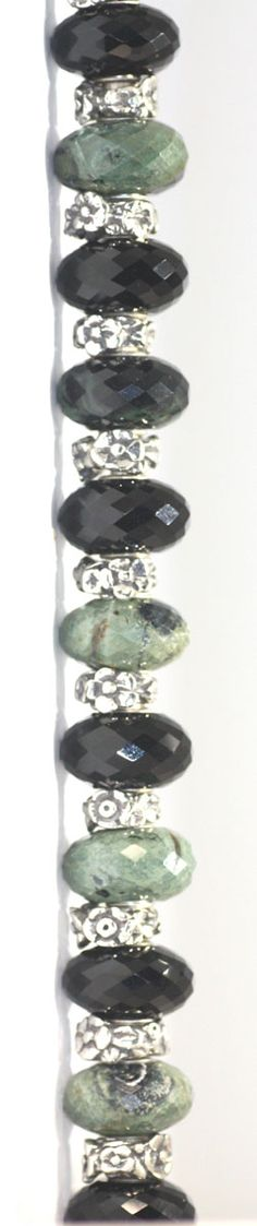 Green Jasper and Black Onyx with Baby's Breath beads. http://www.trollbeadsgallery.com/babys-breath-bead/