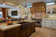 watch TV when doing dishes, also allows you to not be alone when doing dishes. Love! http://sandavy.com/engaging-farm-sinks-for-kitchens-in-traditional-and-contemporary-designs/mediterranean-kitchen-design-darkwood-kitchen-island-wooden-farm-sinks-for-kitchens-design-travertine-tile-floor-brown-marmer-floor-red-apples-in-bowl-stainless-stell-oven-living-room-wide-led-tv/