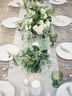 I like the focus on greenery with little bits of neutral florals for tablescapes.