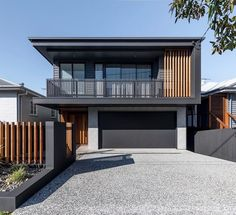 Malcolm Home by Big House Little House Contemporary two-story house located in Brisbane, Australia, designed by Big House Little House. Modern House Facades, Modern House Design, Modern Architecture, House Cladding, Facade House, Japanese Modern House, Duplex Design, Storey Homes, Home Design Plans