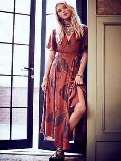 Sweet Escape Wrap Maxi   Maxi wrap print dress featuring easy flutter sleeves and a surplice V-neckline. Lined.