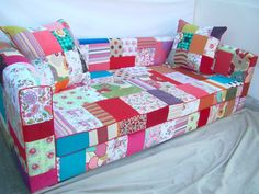 ...wow - the patience it took to do the patchwork, never mind cover the whole sofa!