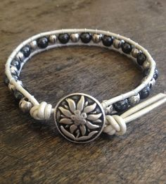 Single Wrap Hematite and Silver, Leather, Flower Bracelet, Surfer Girl Beach Chic. $22.00, via Etsy.