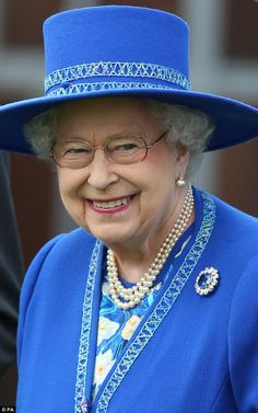 Later in the afternoon, the monarch donned her glasses no doubt to get a better view as she watched the horse racing