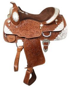 """16"""" Fully tooled Double T Show Saddle with suede leather seat. Saddle features inskirt rigging and accented with tons of silver. Model: 407616 Seat: 16"""" Suede Leather Bars: Semi Quarter horse Swell: 1"""
