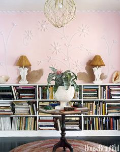 Designed by Gene Meyer and Frank de Biasi, this library features seahorses throughout the room, including the vintage plaster lamps with rattan shades. The pink on the walls, decorated with seashells, is a custom mix that is fitting for this Miami home.   - HouseBeautiful.com
