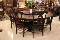 A traditional and conversation inspiring rounded table with matching chairs! #shopGF | Houston TX | Gallery Furniture |