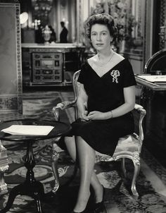 Queen Elizabeth delivers her 1960 Christmas broadcast from Buckingham Palace.