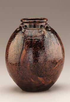 Seto ware Sobokai type tea-leaf storage jar with four lugs  17th-18th century      Edo period     Stoneware with iron and ash glazes  H: 25.7 W: 21.3 D: 21.3 cm   Seto, Japan
