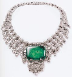 Cartier at the Legion of Honor ~ Commissioned in 1932 by the American Beatrice Mills, who became the Countess of Granard, Cartier created this platinum and rose cut diamond necklace around the center of a 143.23 carat fine rectangular emerald. This necklace is indicative of the geometric style of jewelry that the London Cartier was producing during the 1930's.