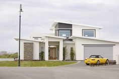 This mono-pitch roof lends itself well to the high ceilings inside and lots of glass facing out to the lake behind. Homesteaders Life, Ice Dam Removal, Garage Plans, Car Garage, Roof Lines, High Ceilings, Tiny Spaces, House Roof, Metal Roof
