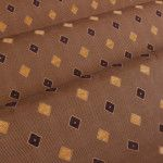 Rotola Jacquard Upholstery in Dusk is a brown and black geometric fabric. This discount designer fabric has a width of 54 inches, a vertical repeat of 3 3/4 inches, and a horizontal repeat of 3 1/2 inches. It is made in Italy from a blend of 80% cotton and 20% acrylic.  This fabric is Cleaning Code S – Solvent Based Cleaner, Dry Clean Only. It is a perfect fabric for interior design and upholstering furniture like sofas, chairs, headboards, ottomans, and chaises.