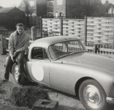 Billy Fury with his car at home.