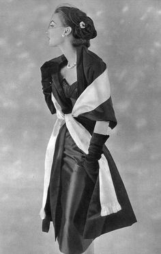 1954 Model in black satin sheath with black and white satin stole by Jacques Fath