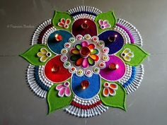Very easy, beautiful and unique multicolored rangoli for Diwali - The Handmade Crafts Easy Rangoli Designs Videos, Easy Rangoli Designs Diwali, Simple Rangoli Designs Images, Rangoli Ideas, Beautiful Rangoli Designs, Rangoli Designs Peacock, Indian Rangoli Designs, Rangoli Designs Latest, Colorful Rangoli Designs