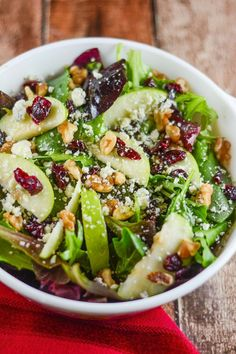 Mixed green salad with spinach, green apples, cranberries, walnuts, and gorgonzola (could also work with brie or feta cheese) with an apple cider vinaigrette