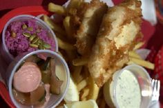 Fish & Chips from Escape Fish Bar in San Diego. The pink slaw and the homemade dips are just icing on the cake for this AMAZING meal. (Everything made on site there from scratch.)