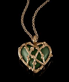 """ENTWINED HEART  The """"Entwined Heart"""" necklace features a large, hand-carved heart set inside twining vines. Delicate but not too sweet, this necklace is perfect layered with our """"Lucky Horn"""" necklace or our """"Lithe"""" necklace. Shown in hand-textured 18k rose gold and Canadian Jade.  3,400 USD"""
