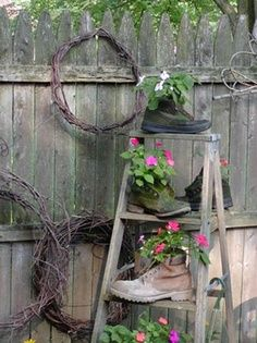 Perhaps with cute shoes.old-wooden-ladder-backyard-decorating-ideas - old ladder plus workboots as planters - (upcycle ladder + garden decor boards) - pb†å Garden Ladder, Garden Junk, Easy Garden, Home And Garden, Garden Ideas, Spring Garden, Garden Planters, Garden Whimsy, Family Garden