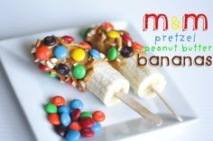 Peanut Butter Banana Pops w/ m's... I know a certain kid who would LOVE these.. but do I want to deal w the mess? Decisions...