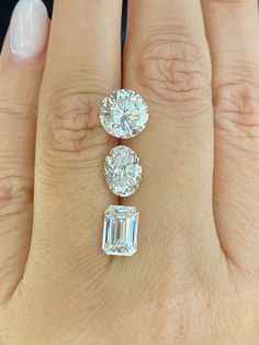 We are obsessed with these diamonds! Featured top to bottom 3.03ct round, 2.01ct oval, and 2.15ct emerald.