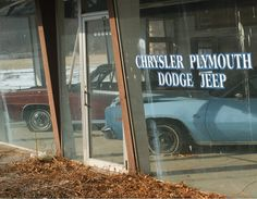 This photo fascinates me. The abandoned old car dealership and abandoned cars in the showroom