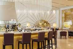 Bar embellished with Gold Mosaic by Martin Brudnizki Design Studio | Oro, Abu Dhabi