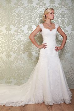 "Stunning Viva Vintage ""De Havilland"" Wedding Dress. It Has Flattering Dropped Waist And A Elegant Shoulder Strap, Complimented By A Demure Sweetheart Neckline. This Gown Is Finished With A Dramatic Lace Train."