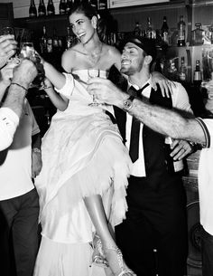 The bride drinking with her guys