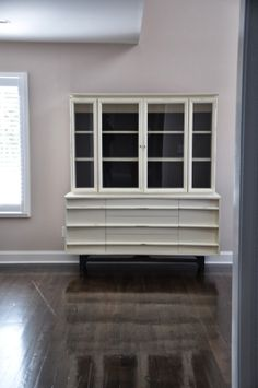 A gorgeous mid-century modern cabinet finished in Old White & Graphite Chalk Paint® decorative paint by Annie Sloan | By Shore Chicy Designs, by Harmonizing Homes
