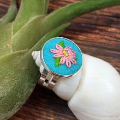 Embroidered floral ring