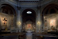 Santa Maria di Loreto, Rome.  Inside standing in the Nave looking toward the High Altar.  The chapel on the right is the Chapel of the Magi, 1586 and the chapel on the left is Chapel of the Crucifix, 1641.