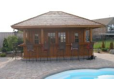 pool house with bar/kitchen on end