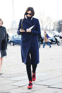 Blue coat, red sneakers.
