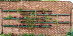 15 Fence Planters That'll Have You Loving Your Privacy Fence Again Vertical Garden Design, Vertical Gardens, Jardim Vertical Diy, Pool Garden, Terrace Garden, Garden Walls, Garden Shower, Brick Garden, Garden Landscaping