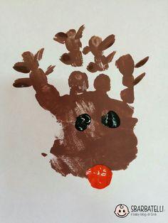 Vi presento Rudolph, la renna dal naso rosso! Per crearla sono bastati una piccola manina e tempera rossa, nera e marrone. La magia del Natale è già nell'aria!