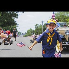 Boy Scouts and Cub Scouts marched in the Ft. Mitchell Independence Day parade along Dixie Highway Saturday, July 4. The Enquirer/Madison Schmidt
