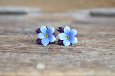 A delicate pair of earrings with blue forget me not flowers which will definitely make your day! innette.etsy.com