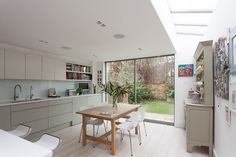 Extension to a period home in Putney. Open plan kitchen dining looking out to the garden and a strip of roof lights that bring light deep into the plan. Open Plan Kitchen Dining, Roof Light, Period, Kitchens, Deep, Lights, Garden, Table, Furniture