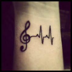 beautiful music tattoo!!!! I love this so much. A tattoo I'd wanted was a heart beat like this with a cross at the end connected to it. Because: the cross is the reason my heart has a beat. However, a treble clef would be amazing tied into it too, as I've been trying to figure out what tattoo to get (later in life) that is a musical tattoo. -kenzi