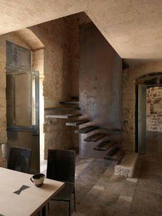 Reminds me of Carlo Scarpa's renovations of Castelvecchio