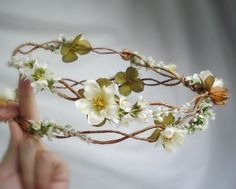 For an earthy wedding  a touch of magic - think Mid Summer Nights Dream - these gorgeous woodland hair wreaths for flower girls not only muster the right look with twisted woven vine, natural dried seed pods, sweet clover, mini roses and white flower garlands, theyll even keep for the next special party so more cost efficient than e.g. a fresh flower wreath!
