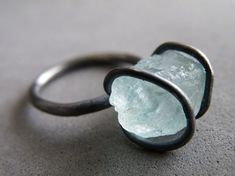 This aquamarine ring features a stunning raw aquamarine stone, held by a handmade sterling silver setting. This cocktail ring has an amazing feel,