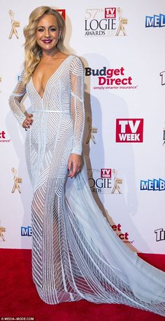 Stunning:Carrie Bickmore showed off her incredible post-pregnancy figure in dangerously l...