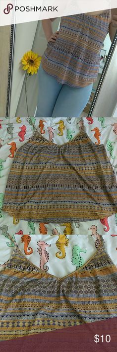 Cute print tank top Tank top from h&m. Size L but would definitely fit an XL. Its a loose fit for size L. And even for an xl. Blue and gold / burnt yellow print H&M Tops Tank Tops
