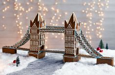 Get your creative juices flowing with this architectural gem - recreate London's iconic Tower Bridge with gingerbread! This delicious gingerbread structure is decorated with dainty gold crisp pearls and blue icing and will really impress your guests.