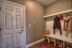 Easy basic mudroom for garage. Put baskets in top to hold hats, mittens, etc. and add cushion for seating area.
