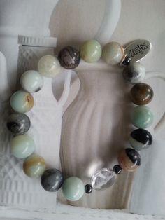 Armband Back to Nature een combinatie van half edelsteen kralen en een facetgeslepen glaskraal in het midden.