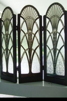 Art Deco Screen, sun motif and triangular patterns can be seen. The sweeping curves seem to be influence by early Egyptian interiors.