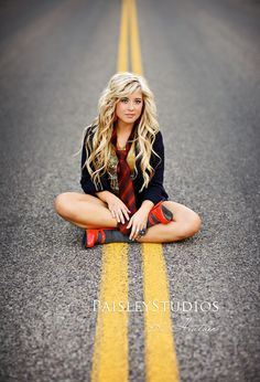 Senior Picture - been seing lots of photos taken in middle of road - good use of leading lines to emphasize subject.